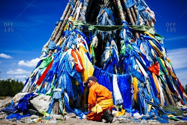 Mongolia - July 16, 2016: Traditional prayer flags adorn a religious site in northern Mongolia