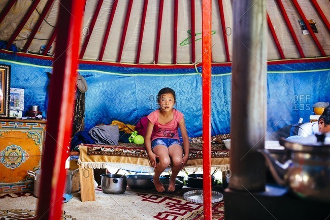 Mongolia - July 17, 2016: A portrait of a young girl in a traditional family ger in Khovsgol Lake in northern Mongolia