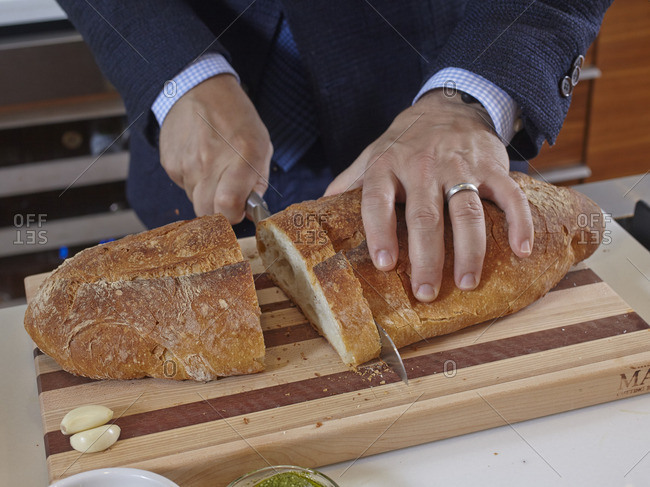 December 25, 2014: Celebrity Chef Geoffrey Zakarian slicing a loaf of bread