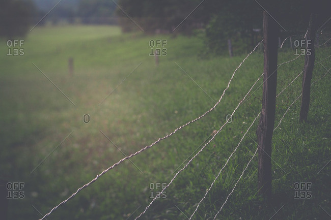 A fence in a mountain field