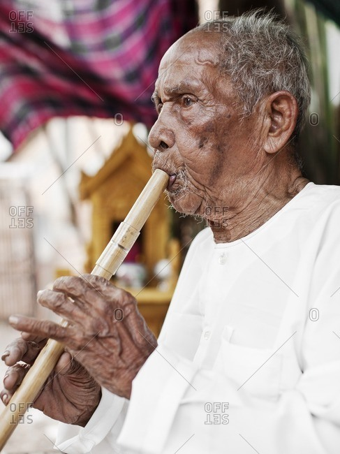 Master musician playing a traditional Cambodian flute