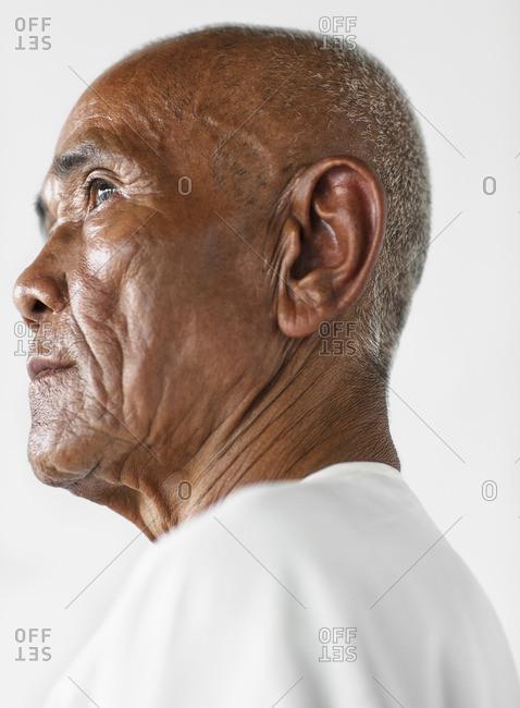 Cambodia - February 19, 2009: Portrait of a senior Cambodian man in white