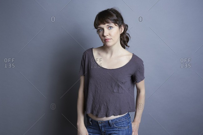 Portrait of a young woman in a gray t-shirt and jeans