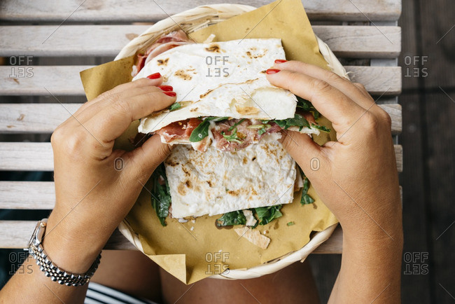 Woman holding a piadina sandwich