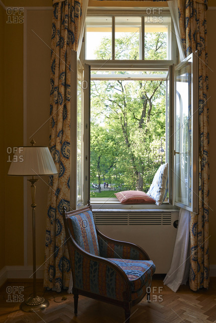 Window seat with a view of a park with trees