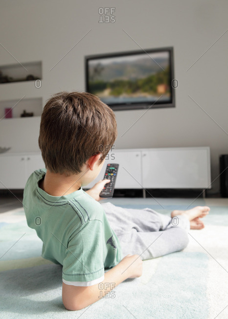 Boy watching television at home