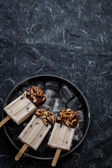 Almond butter blueberry popsicles on an iced tray