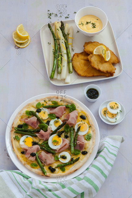 Asparagus, ham and egg pizza and side dish