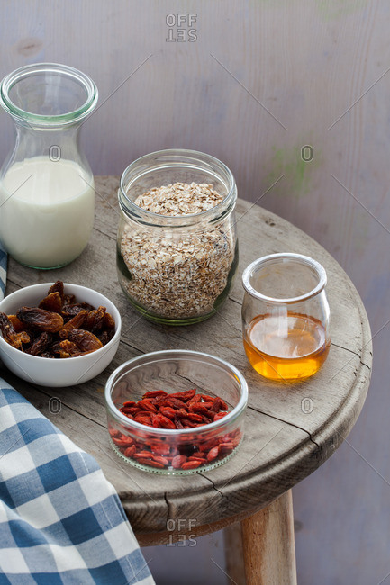 Ingredients for bircher muesli on a small wood table