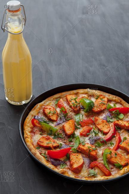 Chicken tikka masala pizza on a table