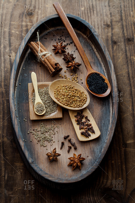 Overhead spices on a wood tabletop