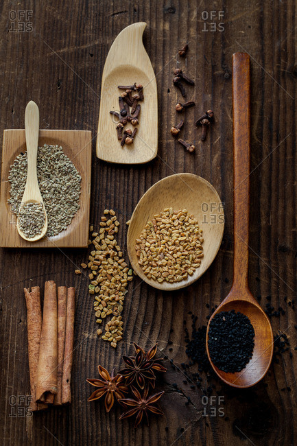 A variety of spices on a wood tabletop