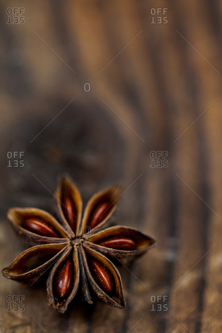 Close-up of star-anise on a wood table