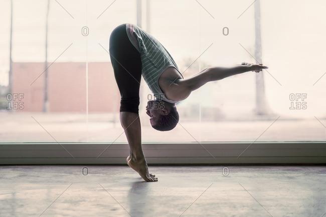 Male ballet dancer warming up in a studio
