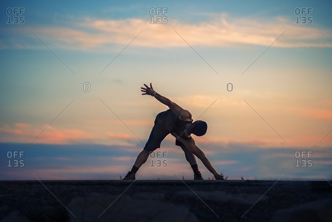 Athletic man stretching before an outdoor workout