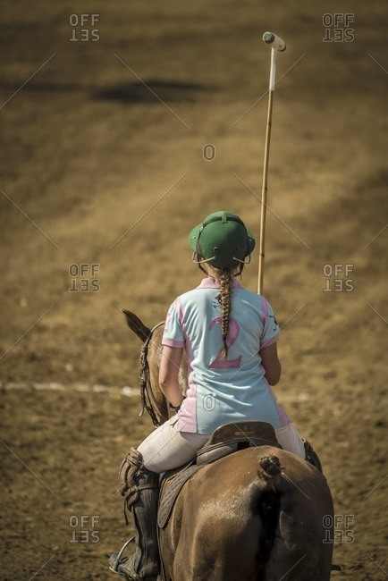 Young polo player waits for match to begin