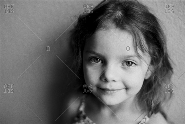 Portrait of a little girl with wavy hair