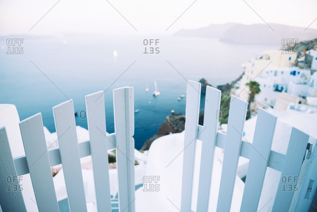Greece- Santorini- Oia- view to the caldera with entrance gate in the foreground
