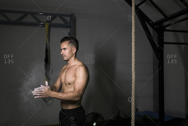 Athlete applying chalk on his hands
