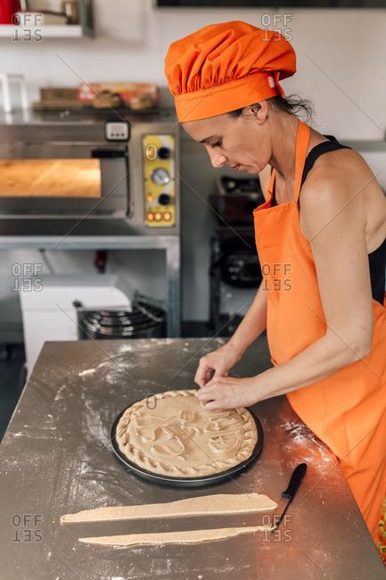 Pizza baker preparing pizza dough