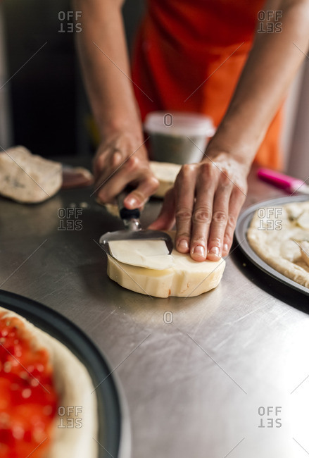 Woman's hand using cheese slicer