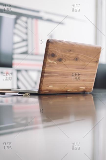 Wooden laptop on desk