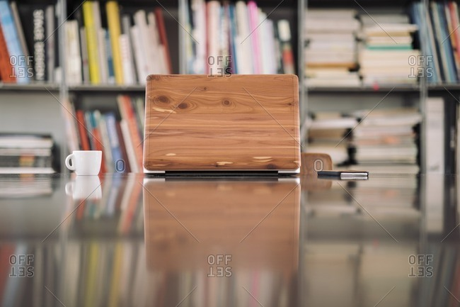 Wooden laptop on desk in library