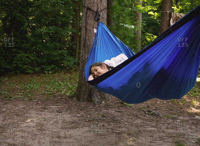 Girl resting in a hammock while camping