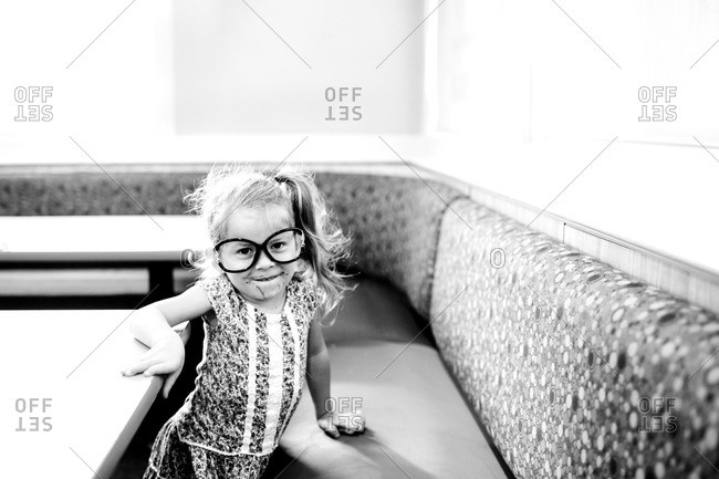 Little girl wearing goofy glasses with a messy face