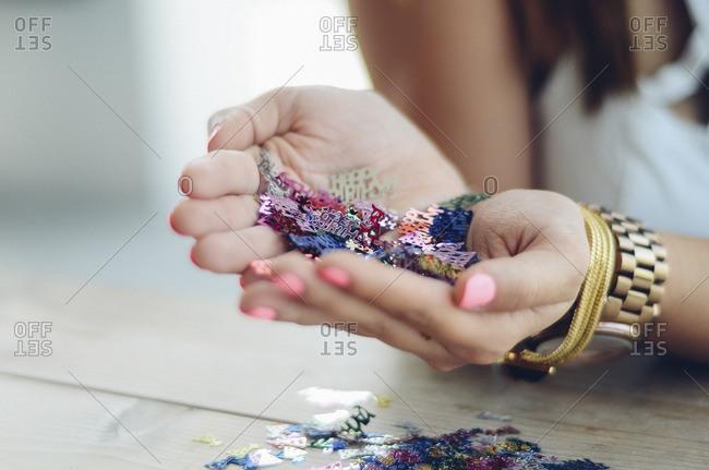Woman holding birthday confetti