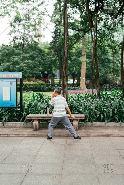 Guangzhou, China - May 18, 2016: Senior Chinese man  practicing Tai Chi in park