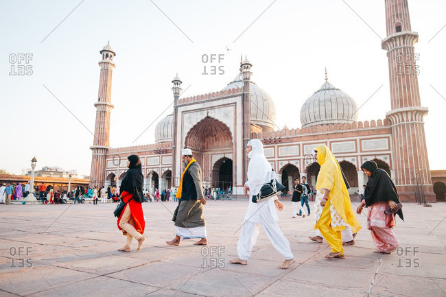 Delhi - May 17, 2016: Visitors walking in front of the Jama Masjid in Delhi