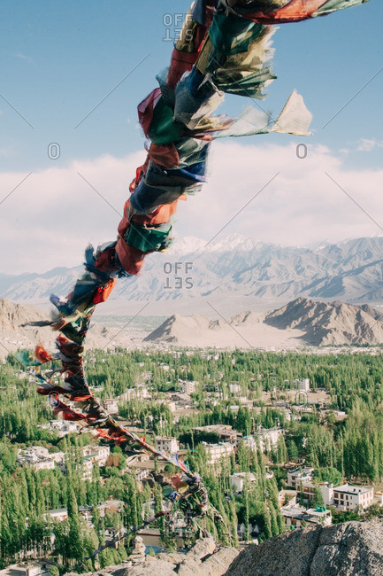 Prayer flags fluttering in the wind over a mountain valley