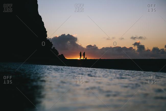 People walking in coastal sunlight