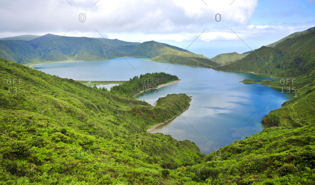 Lake in a mountainous landscape surrounded by forests