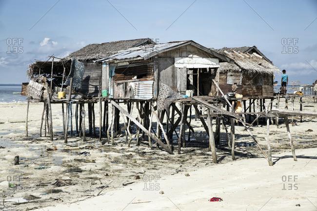 Abandoned fishing huts on a coastal beach