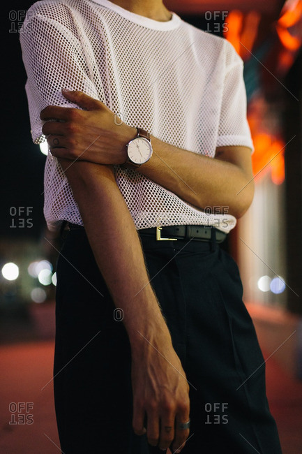 Man in mesh shirt at night