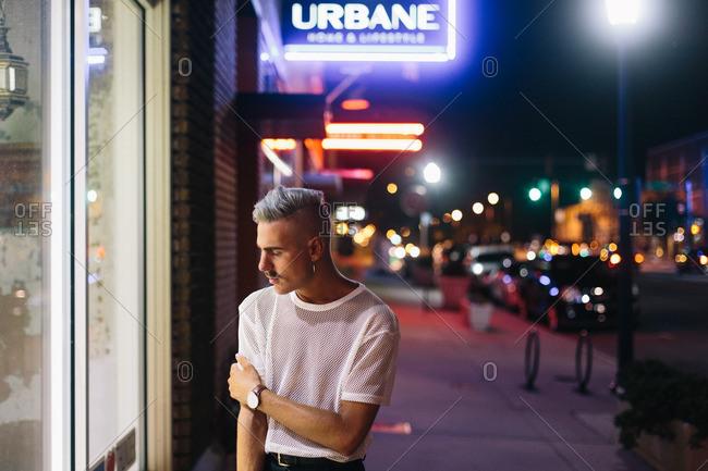 Oklahoma - August 1, 2016: Man in mesh shirt on street
