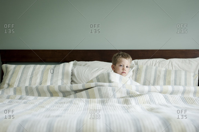 Boy in bed waking up