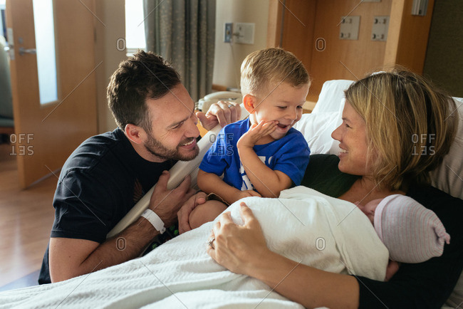 Family spending time together in a hospital after the birth of their baby