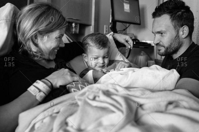 Close-up of a family spending time together in a maternity ward after the birth of their baby