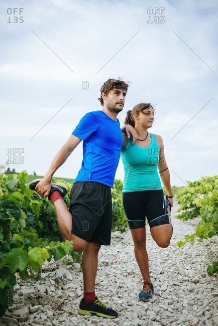 Couple doing sport in a vineyard