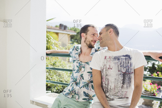 Loving gay couple outdoors