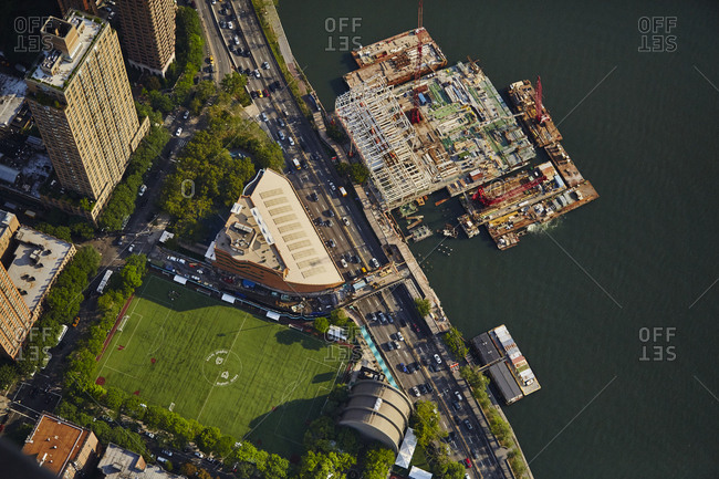July 28, 2015: Aerial view of construction and a sports field in New York City