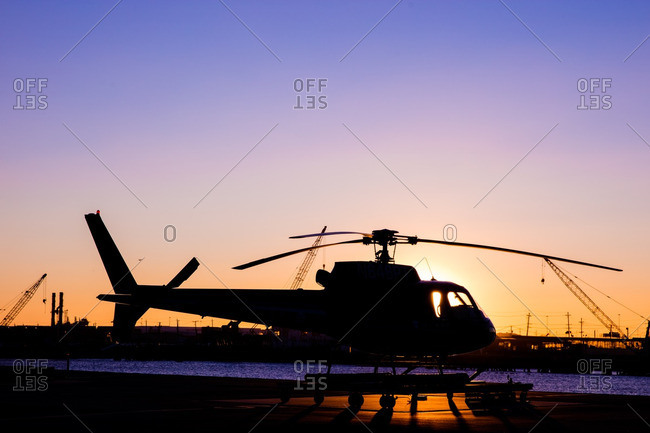 Silhouette of a helicopter on a landing pad in New York City