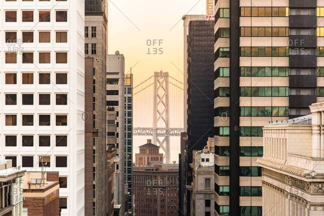 View of the Bay Bridge between buildings in San Francisco, California