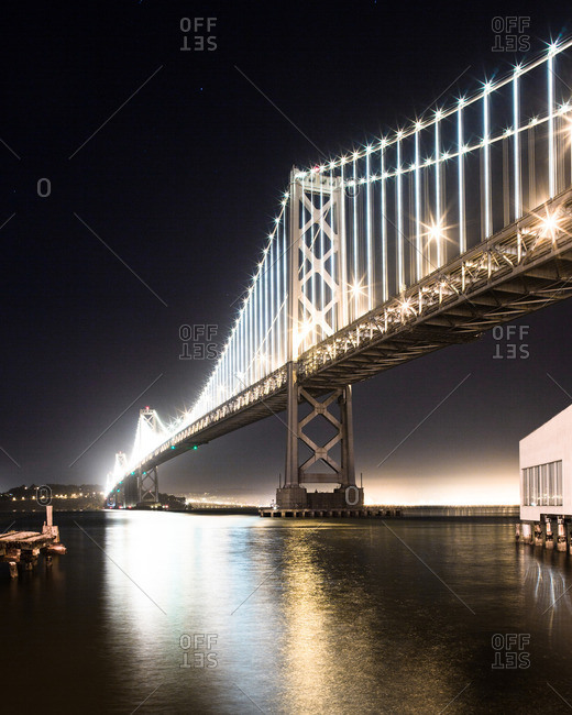 The Bay Bridge illuminated at night in San Francisco, California