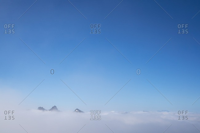 Mountain peaks above clouds at Mount Rainier National Park, Washington