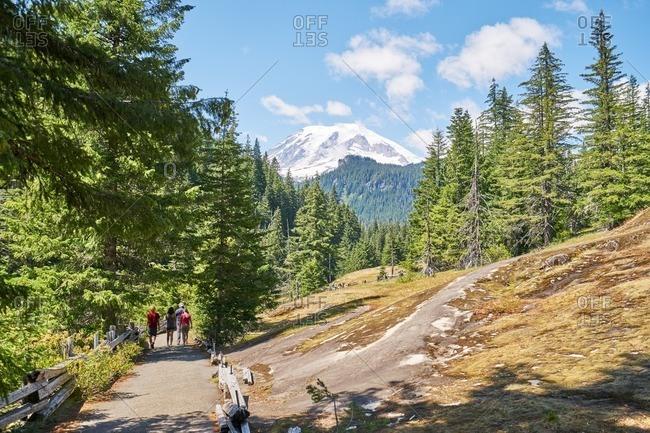 Family walking on trail at Mount Rainier National Park, Washington
