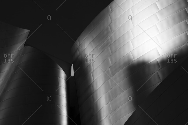 August 17, 2016: Curves of metallic tile on a modern structure